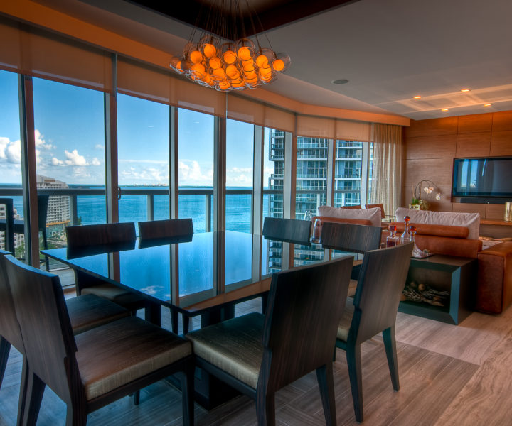Inside view of a modern apartment with view to the bay.